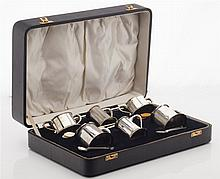 A cased modern condiment set Combined weighable silver: 22oz