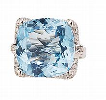 A blue topaz and diamond cocktail ring Ring size: O/P