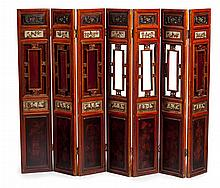 CHINESE RED LACQUER, CARVED AND GILT SEVEN PANEL FLOOR SCREEN LATE 19TH CENTURY 196cm long, 142cm high