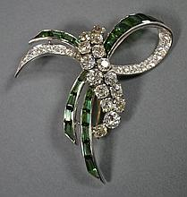 Fine Diamond and tourmaline bow form brooch set in platinum, 16.9 grams total, approximately 6.5 carats in total, 15 large diamonds along with a further 17 diamonds to the side. 6 cm high