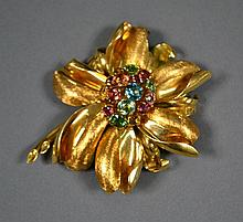 18ct gold floral brooch set with  tutti frutti stones to include sapphire, ruby etc to the centre. 6. 5 cm dia