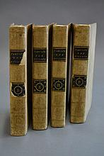 Four beige leather spine volumes