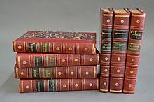 Seven red leather spine volumes