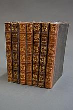 Seven brown leather spine volumes with green cloth
