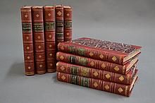Nine marbled, red leather bound books (9)