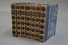 Seven blue leather spine books with marbled cover