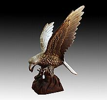 Cast iron, painted life size model of an eagle