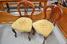 Pair of balloon back dining chairs with floral upholstery