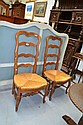 Pair of French Louis XV carved oak ladder back