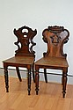 Two antique William IV mahogany hall chairs (2)