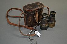 Pair of WWI era field glasses in brown leather
