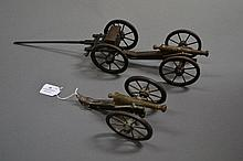 Lot of two model muzzle loading cannons together