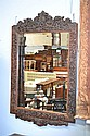 Antique Oriental profusely carved hardwood mirror,
