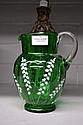 Antique green glass jug with enamel decoration,