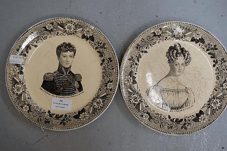 Pair of French Faience portrait plates (2)