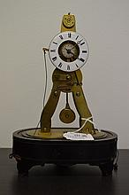 Antique mid 19th century Ms Honarables-France skeleton alarm clock, mounted on an ebonized oval base, with two pull cords, engraved Ms Honorables London & Paris - See Power House Museum item H 4470, approx 23 cm high