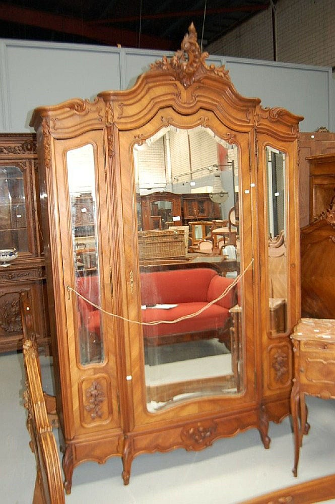 Antique French Louis XV walnut three door armoire,