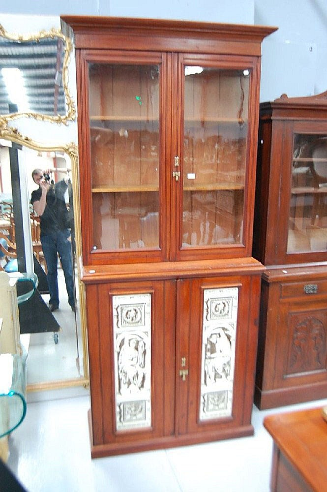 Antique mahogany two height bookcase, the base set