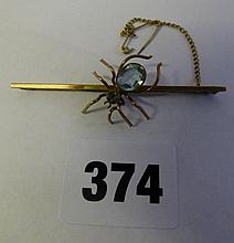 9CT GOLD SPIDER WITH AQUAMARINE BAR BACK BROOCH
