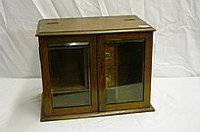 EDWARDIAN OAK TWO GLAZED DOOR SMOKERS CABINET WITH