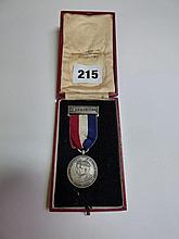 CASED J AND J CASH LTD 1935 MEDAL IN CASE