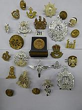 COLLECTION OF MILITARY REGIMENTAL CAP/LAPEL BADGES