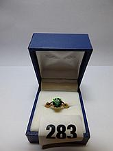 9K GOLD EMERALD AND DIAMOND CLAW SET RING SIZE 0