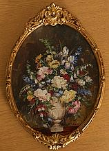Continental School, Still life of flowers in a vase, oval, indistinctly signed, oil on canvas board, framed. 22cm by 16.5cm