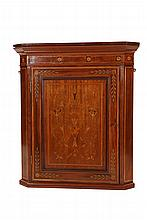 An inlaid mahogany hanging corner cabinet, the canted cornice above a conforming case with flowerhead inlaid frieze above a panel door, banded with satinwood and inlaid with scrolling foliage, painted interior. 86cm by 71cm