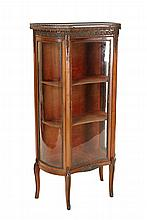A Louis XV style gilt-metal mounted walnut vitrine, the concave galleried marble top with swag-cast apron over an applied band of Vitruvian scroll, above a conforming glazed door and bowed glazed sides, raised on square-section cabriole legs with