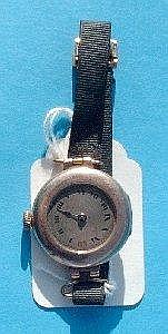 A ladies Rolex 9ct gold cushion cased wrist watch with circular face having roman numeral figures and single blue steeled hand, nickel plated works