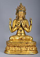 A LARGE GILT BRONZE FIGURE OF FOUR-ARMED GUANYIN