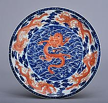 A LARGE RED-BLUE -WHITE DRAGON DISH