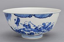 A BLUE AND WHITE BOY'S BOWL