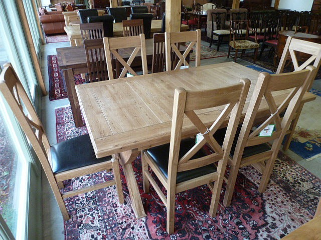 A Chateau cross leg dining table with two